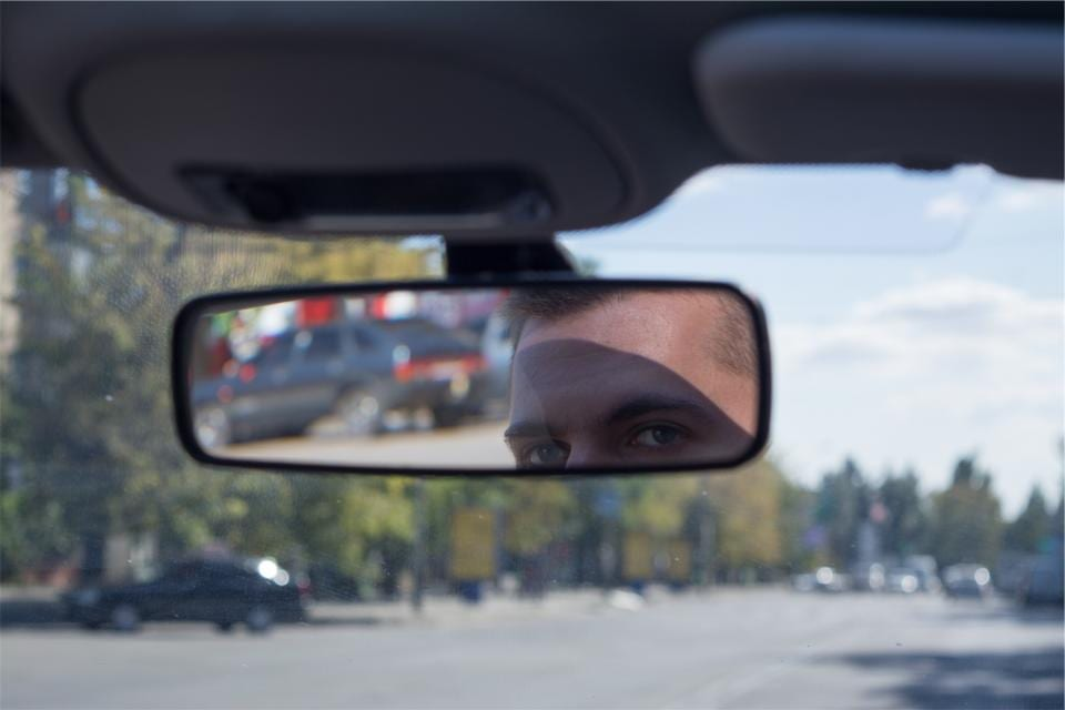 looking in rearview mirrir